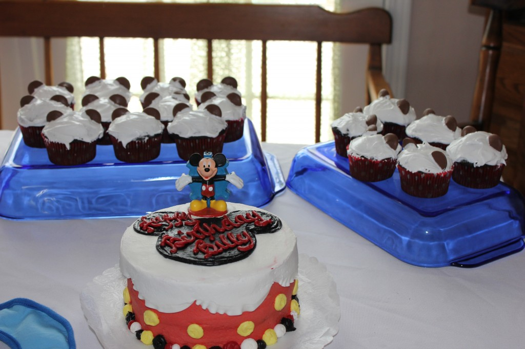 My nephew's adorable Mickey Mouse birthday cake with Mickey inspired cupcakes made by Karen.